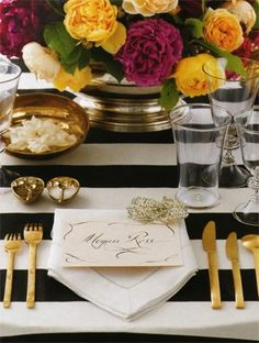 Black and white stripes with gold dinnerware. love this look for new years eve party!!