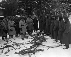 Soviet officers inspecting captured German troops and weapons, near Moscow, Russia, 20 Dec 1941
