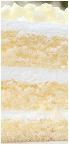 Luscious Lemon Mousse Cake - Layer cake perfection Luscious Lemon Mousse Cake ~ The perfect layer cake. Lemon cake with Limoncello syrup, zesty lemon curd and creamy lemon mousse. (Limoncello liquor is optional. Köstliche Desserts, Lemon Desserts, Lemon Recipes, Sweet Recipes, Baking Recipes, Delicious Desserts, Lemon Cakes, Lemon Curd Dessert, Lemon Layer Cakes