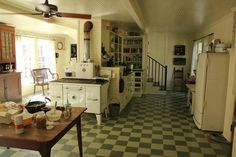 A very cool kitchen |  Check out the back stairs |  Very practical.