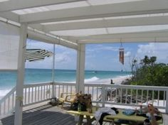 Two-acre stretch of land from beach to bay = beach front property AND a dock!