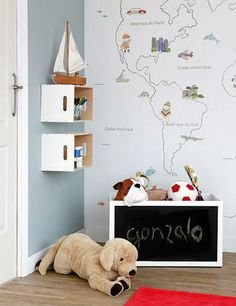 Boxes from Ikea as wall shelves, chalk board paint on a toy chest and love the simple map...