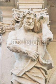 Ornamental statue under a balcony in Bratislava