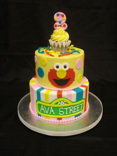A Sesame Street themed buttercream birthday cake by Party Flavors Custom Cakes.