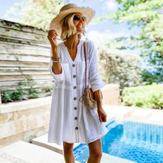 From cabanas to cocktails, the Addison Dress is a versatile vacation staple! 🌴 (Photo: @loverlygrey) #mudpiegift #influencerstyle #whitedress #womenscoverup #cabanatococktials #vacationdress Vacation Dresses, Day Dresses, Summer Dresses, Beach Tunic, White Button Up, Button Front Dress, How To Roll Sleeves, Women's Summer Fashion, Leggings Fashion