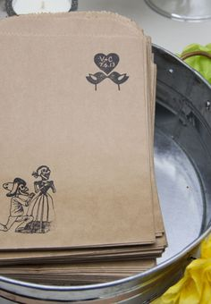 Love the simplicity of the paper bag with the personalized stamp