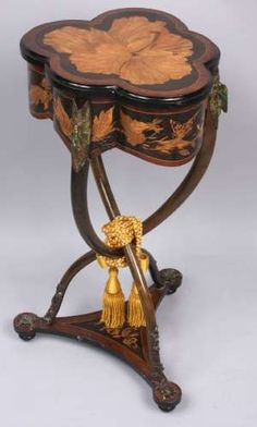 An 1878 Emile Gallé sewing stand featuring an extensive marquetry embellished with figural bronze details including florals, insects and turtles