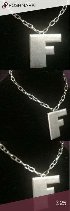 Trifari brand silvertone letter f Trifari brand silvertowne letter f heavy Prime vintage quality 18 inch chain f letter is approximately one and three quarter inches for this listing F stands for freaking awesome! trifari Jewelry Necklaces