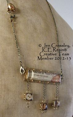 Necklace by Australian artist, Jen Crossley using resin and elements from Susan Lenart Kazmer