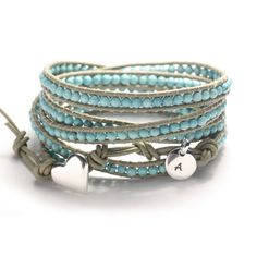 Leather wrap bracelet, Tiny turquoise beads, personalized tag, sterling silver button. $88.00, via Etsy.