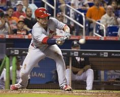 Cards remove Kozma from 40-man roster