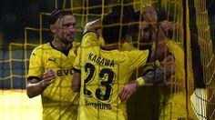 Dortmund players celebrate their goal during their UEFA Europa League play-off second leg against Odd
