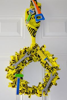 Not Just A Mommy: Real Party - Construction Birthday Party: Activities + Decor This construction themed wreath is made using caution tape and toy tools, and it would a great way to decorate for Workshop of Wonders VBS! Construction Birthday Parties, Construction Party, 3rd Birthday Parties, Boy Birthday, Birthday Ideas, Happy Birthday, Construction Business, Kid Parties, Construction Design