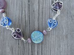 Purple and blue frosted wire wrapped necklace  by MontanaMagic, $20.00  Inspiration: use the same beads i have