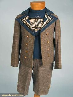 1880 Boy's Suit  Heathered grey, green, black & white small scale plaid breeches and open-front jacket with French blue lapels and sleeveless under vest with white & black soutache braid.