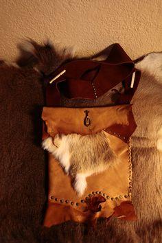Handmade bohemian leather shoulder bag purse. $80.00, via Etsy.
