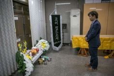 Park Jin-ok paying a silent tribute in front of a refrigerator at a morgue where an unclaimed body was kept.