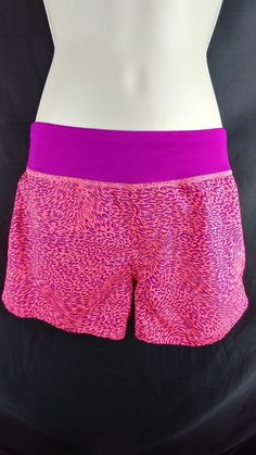 """~Multi-color """"Play-Dry"""" fabric, built-in panty, running shorts. ~Reebok. ~Ladies Size M – 26"""" around the waist. Stretches to 33"""" around the waist. Inseam is 3"""" long. 