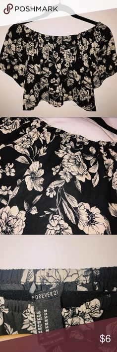 Forever 21 Floral crop top I paired this top with black high-rise jeans and it was sooo cute. Worn 2 or 3 times and has a little bit of string coming off as shown in the last picture. The flowers on the top are a very light tan color. Forever 21 Tops Crop Tops