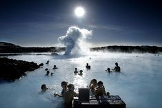 Go to Blue lagoon, Iceland and maybe stay at the Ice Hotel on the way!