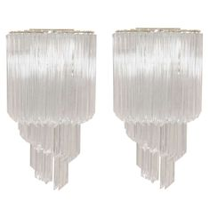 Pair of Spiral Quatrefoil Murano Wall Sconces21 in. (53 cm) WIDTH:11.5 in. (29 cm) DEPTH:7 in. (18 cm) DEALER LOCATION:New York, NY NUMBER OF ITEMS:2 REFERENCE NUMBER:13121383061871