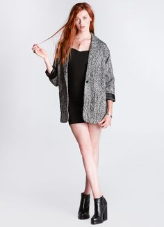 """Oversized blazer featuring front patch pockets, single button closure, and detachable faux fur collar. Fully lined.  80% Polyester, 20% Wool Lining: 100% Polyester 29"""" length Model is wearing size XS"""
