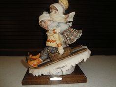 "G. Armani Capidomonte ""Sledding"" figurine"