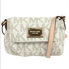 """Michael Kors crossbody purse! Vanilla MK signature logo pattern PVC with tan leather trim and gold hardware.  Flap top with magnetic snap closure.  Inside is lined and includes an open slip pocket.  Single tan leather adjustable crossbody/shoulder strap with a drop measurement of 22""""-24"""".  Bag measures approx. 7"""" x 5"""" x 2.5""""  092116 Michael Kors Bags Crossbody Bags"""