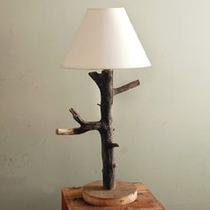 Light things up with this simple DIY branch table lamp.