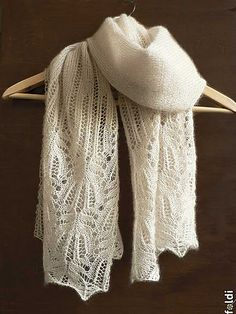 Panna Frost Flower Lace Shawl by Foldi knit. Machine knit but hand knit pattern is available on link.
