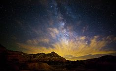 Fiery Night In Palo DuroThe stars at night are truly big and bright deep in the heart of Texas. I captured this image of the Milky Way rising above Palo Duro Canyon on a... more  by Stephen Stookey