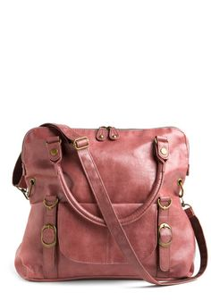 Earthen Rose Bag, #ModCloth...$80...The rosy-clay, vegan faux leather is surely unique, while the rich brown liner is functional with pockets for almost anything. Wear the bag hanging from your arm by the attached straps or fold the top over and buckle on the longer, adjustable strap to sling it on your shoulder. A front pocket and decorative buckles add flair!