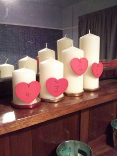 Advent candles 2014. Pillar candles from Tesco direct pinned with wooden gift tags from Tiger stores.