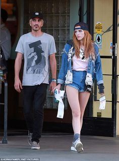 Denim days: Flaunting her never ending legs, Disney star Bella slipped into a pair of thig...