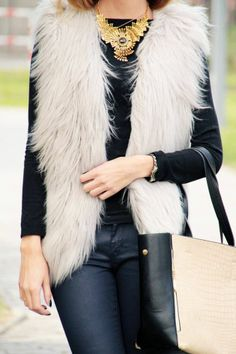 The tactile sense of this fashionable fur vest can easily be imagined. This faux fur vest is an example of a texture that looks as if it has both a smooth and warm touch.