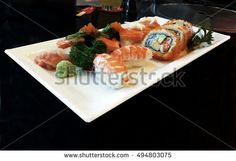 Sushi set isolated on black background.
