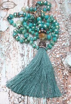 Aqua Silk Tassel Necklace, Boho Tassel Necklace, Turquoise Boho Chic Necklace, , Gift for her A Unique , beautiful, Aqua Hand knotted , Long Tassel Necklace . Features antique rhinestones, different shades and shapes of turquoise- green sparkling crystal beads , emerald green