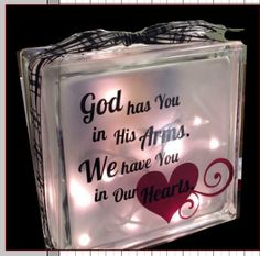 This glass block is 7.5 x7.5 x 3. Picture is printed on transparency and decorated with name and dates. On the back is the saying God has you