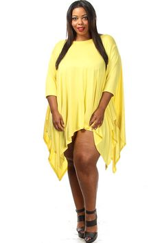 This fresh plus size dress has a solid body, scoop neck , and draped bottom. Soft, stretch material 96% Polyester 4% Spandex Model wearing 3X Made in USA