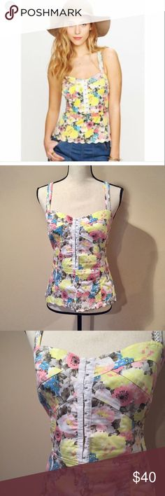 Free People floral corset top Euc, corset clasps down most of the front, half zip on the side. Straps can cris cross or be straight. Size 12. No trades, no PP, no offsite transactions. Dog friendly smoke free home. I will gladly provide measurements if asked😊 Free People Tops Tank Tops