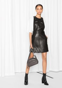 & Other Stories image 1 of Leather Pinafore Dress in Black Black Ankle Boots Outfit, Black Leather Ankle Boots, Pinafore Dress Outfit, Black Pinafore, White Oversized Sweater, Cutout Boots, Black Heels Low, Black Platform Boots, Frack