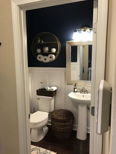 Powder room remodel! Board and batten, navy and white, gold and silver touches.