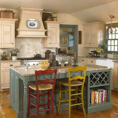 like the island with wine rack, cookbook shelving, and mismatched bar stools.  All in one is great!