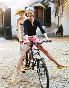 What makes this shot so great is that these women are dressed adorably and look classy. Throw in the bicycle and the cute backdrop, and it's a photograph!