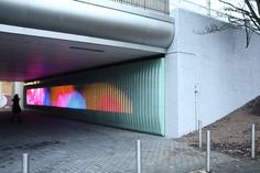 Media architecture collective Urban Alliance created 'The Moodwall', close to the Amsterdam Bijlmer subway station. The artwork located in a pedestrian tunnel and has the purpose to make this creepy dark tunnel place a bright spot of social interaction and inpiration.