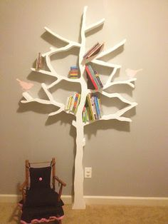 DIY Tree Bookshelf- would be cute for picture frames for family