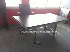 national business furniture conference table assembled in Washington DC by Furniture assembly experts LLC - call (202) 787-1978