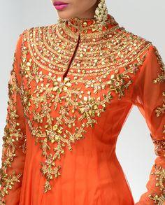 Tangerine Orange Anarkali Suit with gold work done on it.