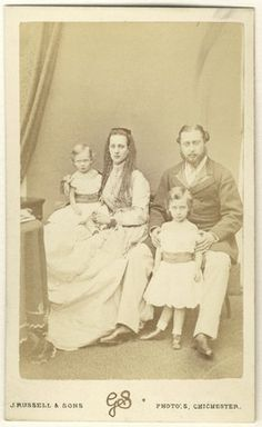 Prince Albert, Queen Victoria's eldest son, with his wife Princess Alexandra and their 2 eldest children, Prince George, later George V (left) and Prince Albert Victor (right)