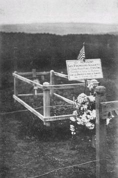 GRAVE OF FIRST AMERICAN KILLED IN FRANCE. Translation: Here Lie the First Soldiers of the Great Republic of the United States of America, Fallen on French Soil for Justice and for Liberty, November 3rd, 1917